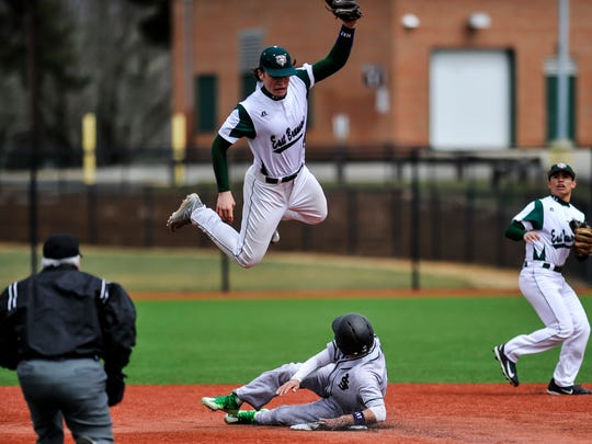 East Brunswick's James Schuld leaps over St Joe's Jonathan Sot as he steals second base during a game in East Brunswick on April 1, 2017.