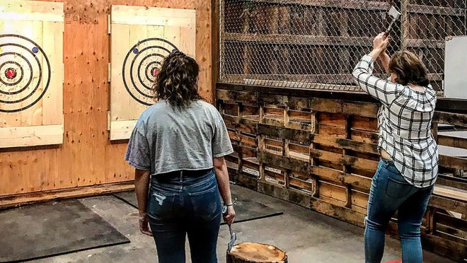 This is a scene from Pocono Axe Works' Facebook page, showing men throwing axes at targets. Both men and women try their hand at the activity in Lakeville, PA. See more at: https://www.facebook.com/poconoaxeworks