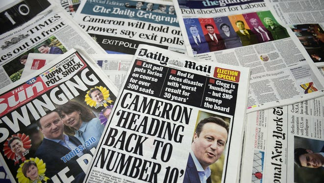 A picture of an arrangement of British newspapers carrying headlines dominated by exit poll forecasts in favor of the Conservative Party in the British general election taken in London on May 8, 2015.