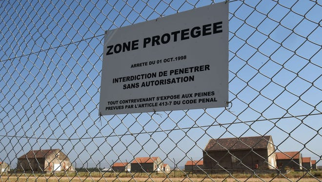 A picture taken on July 7, 2015 in the French southern city of Miramas partially shows a regional military ammunition camp where at least 150 detonators and plastic explosives were stolen on the night of July 5 to 6.