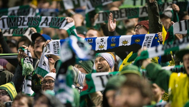 Portland Timbers fans cheer after a goal during the second half in a game against the Colorado Rapids during their MLS soccer game in Portland, Ore., Sunday, Oct. 25, 2015. The Timbers won 4-1.