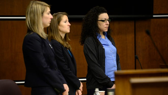 From left, Defense attorneys Kathryn Herold and Jen Beck stand with Dynel Lane as the jury enters the courtroom before closing statements in Boulder, Colo., on Monday, Feb. 22, 2016.
