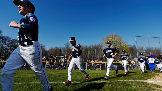 The Red Land Little League 2015 U.S. World Series Championship team takes the field after a parade of younger Red Land Little League teams on opening day in Newberry Township. Members of the 2015 U.S. World Series Championship team were honored during the celebration and presented with rings.