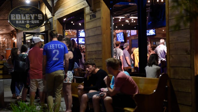 Diners wait to enjoy Edley's Bar-B-Que.