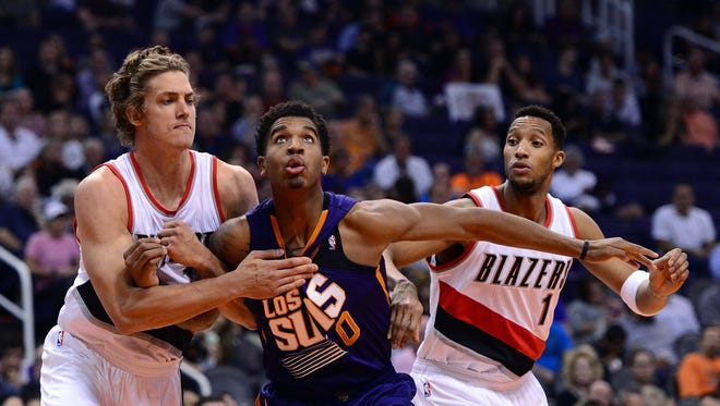 Phoenix Suns forward Marquese Chriss (0) boxes out Portland Trail Blazers forward Meyers Leonard (11) and guard Evan Turner (1) during the first half at Talking Stick Resort Arena.