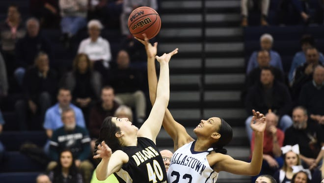 Dallastown's Aniya Matthews (22) wins the tipoff against Delone's Bradi Zumbrum, Wednesday, Feb. 13, 2018. The Dallastown Wildcats beat the Delone Catholic Squires, 52-42, to advance to the YAIAA championships.