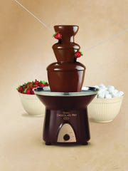 The Wilton Chocolate Pro holds up to four pounds of