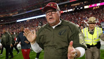 Arizona Cardinals coach Bruce Arians celebrates after beating the Cincinnati Bengals 34-31 in an NFL game on November 22, 2015 in Glendale.