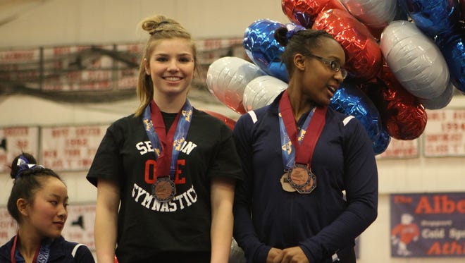 Wappingers' Olivia Frederick finished tied for fourth on the uneven bars at Saturday's NYSPHSAA Championships at Cold Spring Harbor High School on March 5th, 2017.
