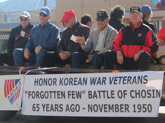 Koren War Veterans wave to the crowd during the annual Veterans Day Parade.