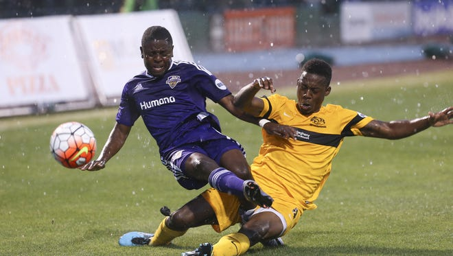 Sam Upshaw Jr./The CJ Louisville City FC?s Kadeem Dacres collides with the Pittsburgh Riverhounds? Jordan Murrell. Louisville City FC's Kadeem Dacres, #7, collides with Pittsburgh Riverhounds' Jordan Murrell, #4, during their match at Slugger Field. Apr. 27, 2016