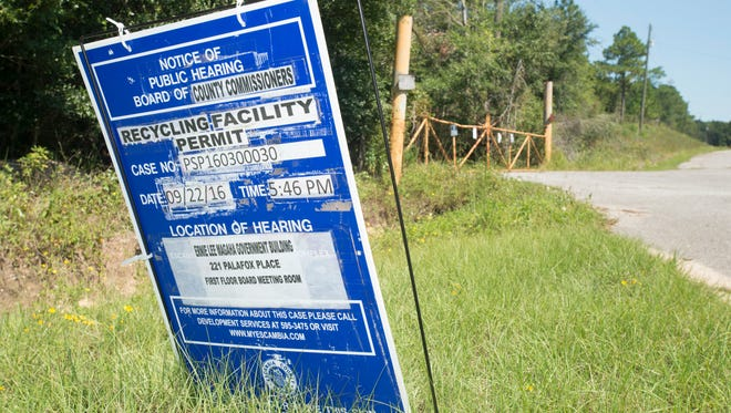 A sign notifying the public of a County Commission hearing about the proposed Wedgewood Recycling Facility on Longleaf Drive in Pensacola on Wednesday, September 21, 2016.