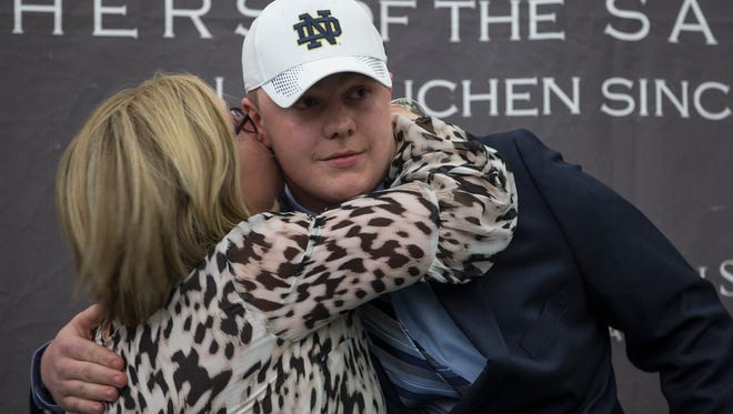 Olmstead gets a congratulatory hug from his mother Pat. John Olmstead commits to Notre Dame for his college football career. The announcement was made with friends, family, and teammates at St. Joseph High School.  Metuchen, NJFriday, April 20, 2018@dhoodhood