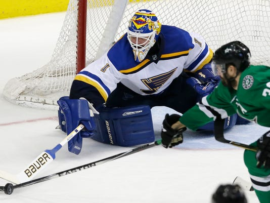 St. Louis Blues goalie Brian Elliott (1) defends the goal against Dallas Stars center Vernon Fiddler (38) during the third period of Game 7 of the NHL hockey Stanley Cup Western Conference semifinals Wednesday, May 11, 2016, in Dallas. The Blues won 6-1. (AP Photo/LM Otero)