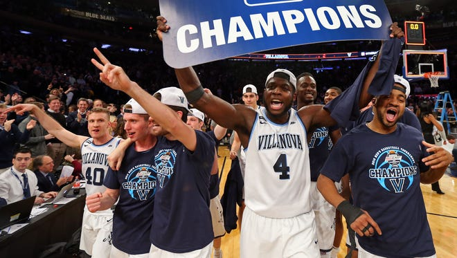 Villanova forward Eric Paschall and teammates celebrate after beating Providence to win the 2018 Big East tournament.