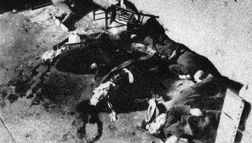 The bodies of some of the seven men who were slain in the gangland St.  Valentine's Day massacre on Chicago.