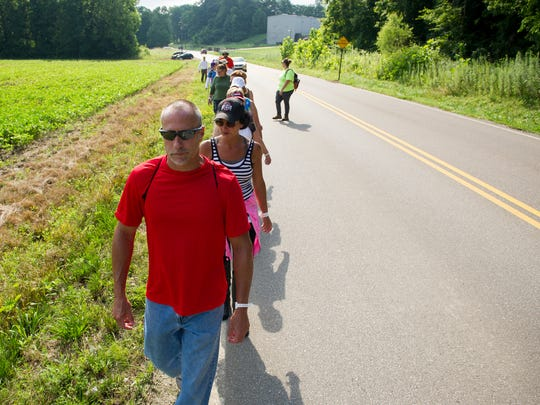 Brad and Kellie Waller, both of Evansville, (from left) along with others search for Aleah Beckerle along Wolf Hills Road in Henderson, Saturday, July 30, 2016. More than 50 people came out Saturday to search for Beckerle who has been missing since July, 17.