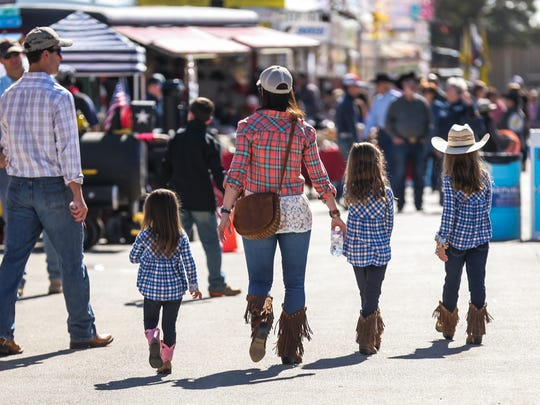 Visitors stroll in the midway during the San Angelo Stock Show & Rodeo Sunday, Feb. 4, 2018, at the fairgrounds.