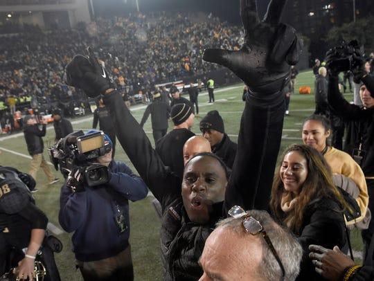 Vanderbilt head coach Derek Mason celebrates his team's
