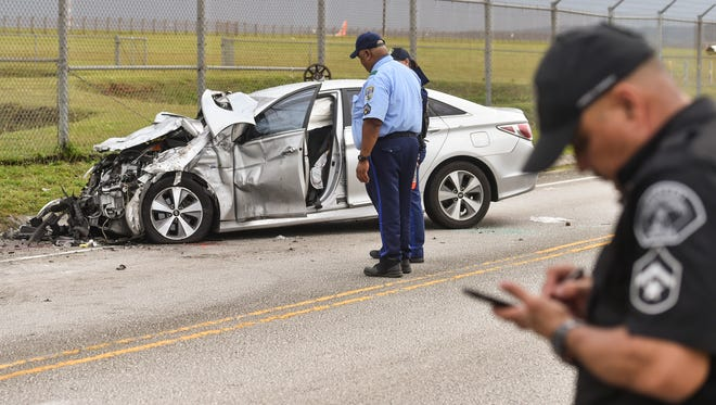 In this April 24 file photo pfficers from the Guam Police Department and Airport Police investigate a two car collision in Tiyan. The crash involving the silver Hyundai Sonata and a Ford Ranger pickup sent two people to the hospital, according to Guam Fire Department.