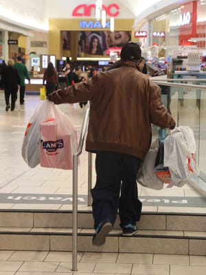 Wallic Shabazz of Rutherford heads home after purchasing last-minute gifts.