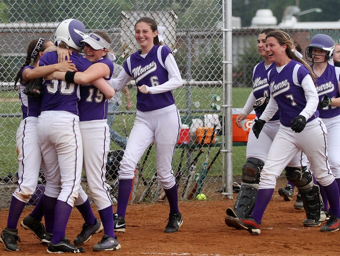 Monroe players celebrate after Sarah McGrath, #30, scored the game-winning run against Bishop Ahr in the GMC Tournament, Thursday, May 22, 2014, at South Plainfield High School in South Plainfield, NJ.