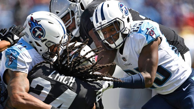 Oakland Raiders running back Marshawn Lynch (24) is covered up by Tennessee Titans players at Nissan Stadium Sunday, Sept. 10, 2017 in Nashville, Tenn.