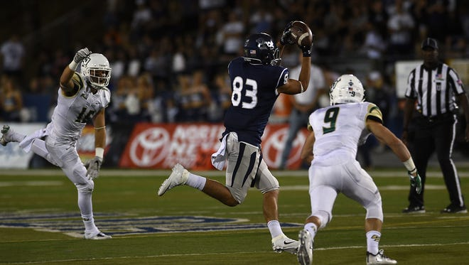 Nevada's Andrew Celis makes a catch in traffic in Friday's win over Cal Poly. Celis, a sophomore, had his first college reception Friday.