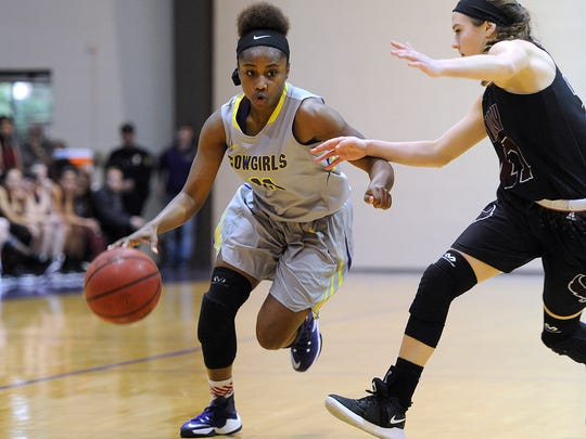 Hardin-Simmons' Jasmine McClellan (11) drives to the basket while being guarded by McMurry's London Weilert (21) during the second quarter of the Cowgirls' 68-53 win on Saturday, Jan. 21, 2017, at HSU's Mabee Complex.