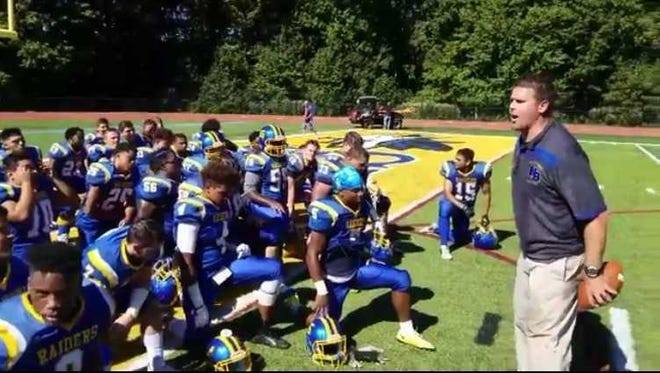North Brunswick High School football coach Mike Cipot address team after 13-6 victory over Carteret