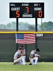 Dejected Frontier outfielders during a pitching change against Pioneer on Friday night.