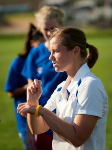Sign language interpreter Catie Johnson signs instructions to University of Kansas women's soccer player Emily Cressy during a recent practice. As a freshman, Cressy, who is deaf, was named Big-12 rookie of the Year and 2008 USA Deaf Sports Federation Sportswoman of the Year.