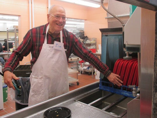 The benefit for Brian Grube on Saturday drew many volunteer helpers. Jim Loomis took his place in the kitchen washing dishes.