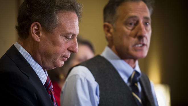 Michael Goldberg, left, a court-appointed lawyer who now is effectively in charge of all operations at both Jay Peak and Q Burke, holds a news conference with Gov. Peter Shumlin at Hotel Jay on Wednesday.RYAN MERCER/FREE PRESS