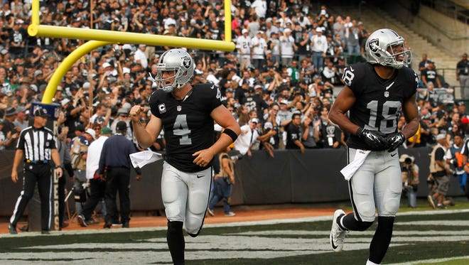 Nov 1, 2015: Oakland Raiders quarterback Derek Carr (4) reacts after throwing a touchdown pass against the New York Jets in the third quarter at O.co Coliseum. The Raiders defeated the Jets 34-20.