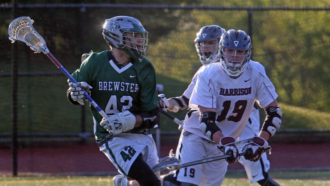 Brewster's Kevin Blank (42) looks to score on Harrison during boys lacrosse Section 1 Class B playoff game at Harrison High School on May 16, 2016.