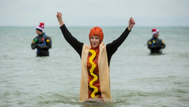 Kim Bowman, of St. Clair, is dressed as a hot dog during the 2016 Kiwanis Polar Bear Plunge at Lakeside Park in Port Huron.