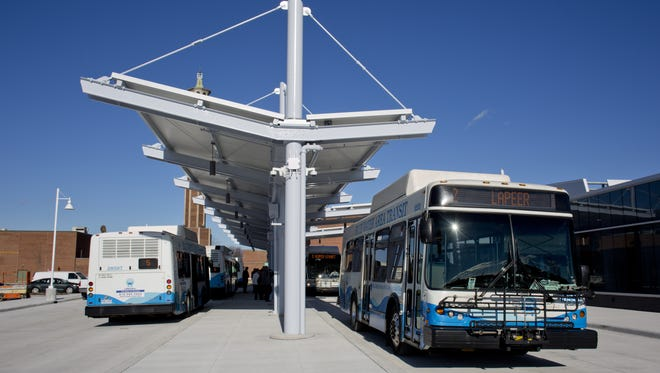 Buses that use compressed natural gas depart the Blue Water Transit Bus Center in downtown Port Huron. The transit authority has received a $1.5 million federal grant to but electric buses and chargers
