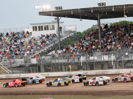 Oshkosh SpeedZone Raceway drivers compete on the dirt track at the at the Winnebago County Fairgrounds in this 2012 file photo.