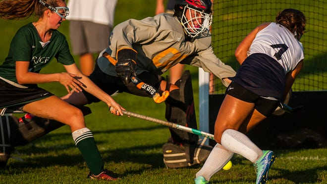 Rice keeper Emily Rachek races to block a shot from Essex #4 August Spagnuolo-Chawla during their field hockey game at Essex High School on Monday night, Sept. 25, 2017.