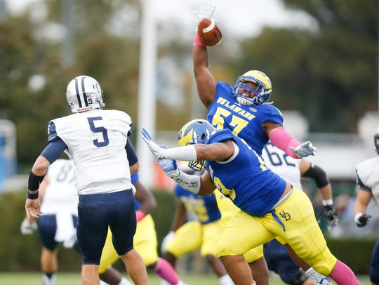 Delaware defensive lineman Grant Roberts knocks down
