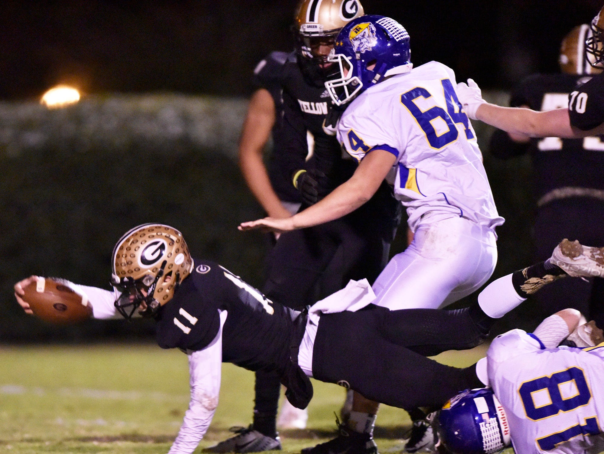 Greer's Mario Cusano (11) sails into the end zone against Travelers Rest.