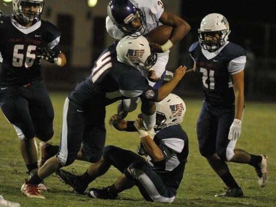 Tulare Western Matt Lopez takes down Fresno during
