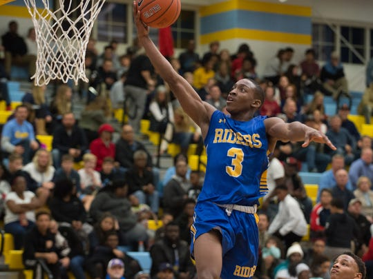 Caesar Rodney's Davione Robinson (3) goes up for a layup in their game against Cape Henlopen.
