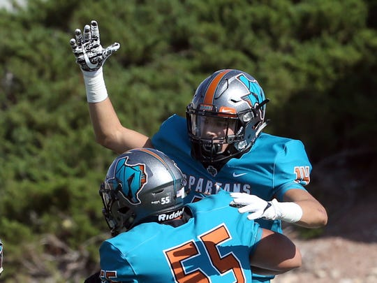 Pebble Hills wide receiver Haredt Gonzalez, 14, celebrates a touchdown against Irvin with teammate Ivan Ibarra, 55, Thursday at the Socorro Activities Complex.