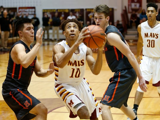 Robert Phinisee of McCutcheon drives to the basket for a shot against Harrison Friday, December 15, 2017, at McCutcheon High School. McCutcheon pounded rival Harrison 91-34.
