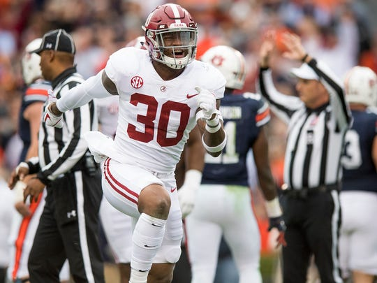 Alabama linebacker Mack Wilson (30) celebrates recovering an Auburn fumble in first half action in the Iron Bowl in Auburn, Ala. on Saturday November 25, 2017.