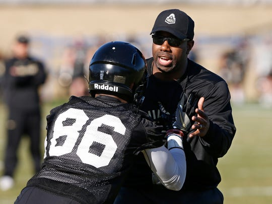 Co-offensive coordinator and wide receivers coach JaMarcus Shephard runs redshirt freshman wide receiver Noah Ellison run through a drill during the first day of Purdue spring football practice Monday, February 26, at the Bimel Practice Complex.