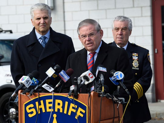 U.S. Senator Bob Menendez, center, with Essex County Executive Joseph DiVincenzo, left, and Sheriff Armando Fontoura speaks at the Essex County Police Academy in Cedar Grove during a demonstration on the lethality of the AR-15 assault rifle   Chris Monroe/ Special to NorthJersey.com