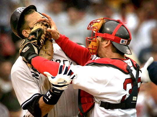 New York Yankees' Alex Rodriguez, left, is pushed by Boston Red Sox catcher Jason Varitek, right, after Rodriguez was hit by a pitch from Red pitcher Bronson Arroyo during a 2004 game.